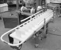 Packaging System Uses Cleated LP Series Mini-Mover Conveyors